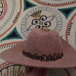 Light brown with feathers hat.